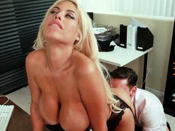 Fake-titted Latina with blonde hair Bridgette B is stretched from behind in the office room.
