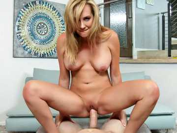 Passionate blonde milf Brett Rossi undresses and sits upon dick of her husband